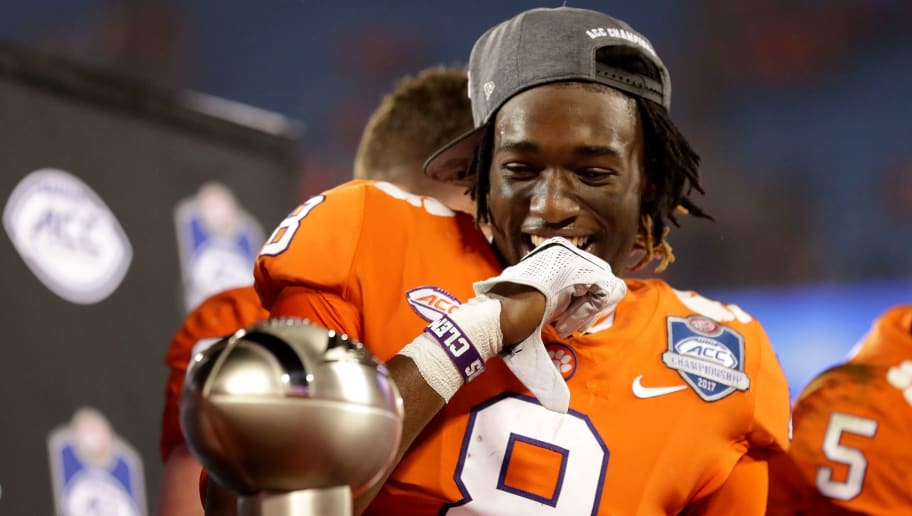 CHARLOTTE, NC - DECEMBER 02:  Deon Cain #8 of the Clemson Tigers reacts to seeing the trophy after the ACC Football Championship at Bank of America Stadium on December 2, 2017 in Charlotte, North Carolina.  (Photo by Streeter Lecka/Getty Images)