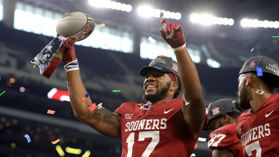 ARLINGTON, TX - DECEMBER 02:  Jordan Smallwood #17 of the Oklahoma Sooners raises the Big 12 Championship trophy after defeating the TCU Horned Frogs at AT&T Stadium on December 2, 2017 in Arlington, Texas.  (Photo by Ronald Martinez/Getty Images)