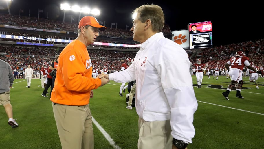 TAMPA, FL - JANUARY 09:  Head coach Dabo Swinney of the Clemson Tigers (L) talks with Head coach Nick Saban of the Alabama Crimson Tide prior to the 2017 College Football Playoff National Championship Game at Raymond James Stadium on January 9, 2017 in Tampa, Florida.  (Photo by Kevin Jairaj - Handout/Getty Images)