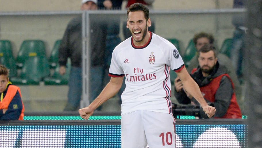 VERONA, ITALY - OCTOBER 25:  Hakan Calhanoglu   of AC Milan celebrates after scoring his team's third goal during the Serie A match between AC Chievo Verona and AC Milan at Stadio Marc'Antonio Bentegodi on October 25, 2017 in Verona, Italy.  (Photo by Dino Panato/Getty Images)