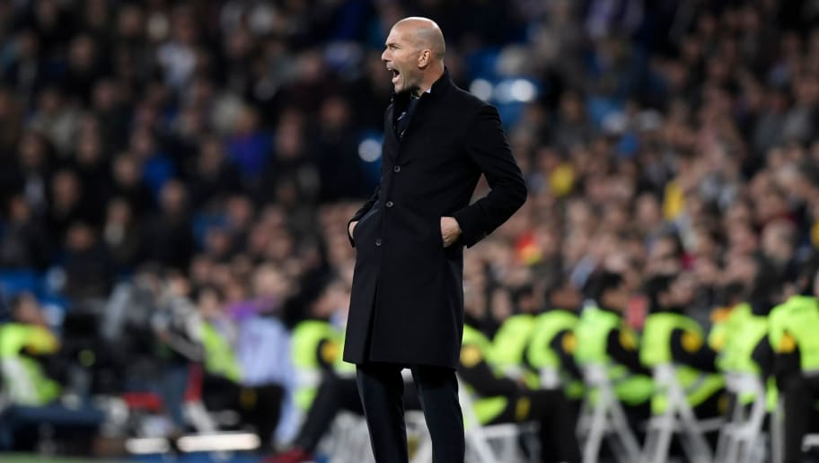 Real Madrid's French coach Zinedine Zidane reacts during the Spanish league football match Real Madrid CF vs UD Las Palmas at the Santiago Bernabeu stadium in Madrid on November 5, 2017. / AFP PHOTO / GABRIEL BOUYS        (Photo credit should read GABRIEL BOUYS/AFP/Getty Images)