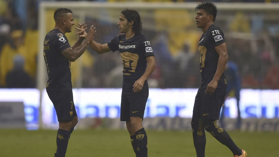 Pumas's forward Matias Britos (C) celebrates with teammates after scoring a goal against America during their Mexican Apertura 2016 Tournament football match at the Azteca stadium on September 24, 2016, in Mexico City. / AFP / YURI CORTEZ        (Photo credit should read YURI CORTEZ/AFP/Getty Images)