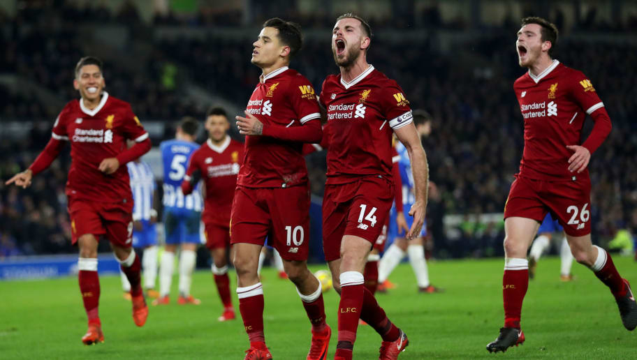 BRIGHTON, ENGLAND - DECEMBER 02:  Philippe Coutinho of Liverpool celebrates with team-mates including Jordan Henderson after scoring his team's fourth goal during the Premier League match between Brighton and Hove Albion and Liverpool at Amex Stadium on December 2, 2017 in Brighton, England.  (Photo by Dan Istitene/Getty Images)