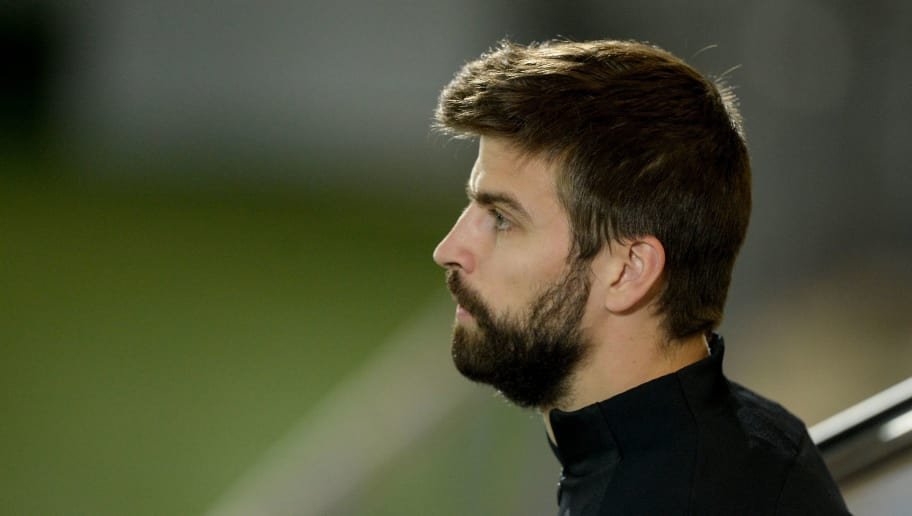 Barcelona's defender Gerard Pique looks on during a training session at the FC Barcelona Joan Gamper sports center in Sant Joan Despi, near Barcelona on November 25, 2017. / AFP PHOTO / Josep LAGO        (Photo credit should read JOSEP LAGO/AFP/Getty Images)