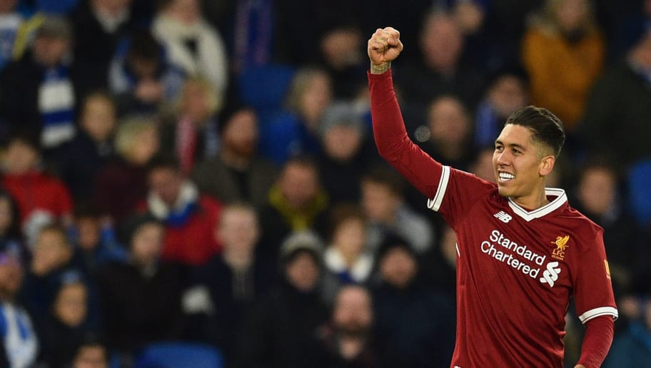 Liverpool's Brazilian midfielder Roberto Firmino celebrates scoring their third goal during the English Premier League football match between Brighton and Hove Albion and Liverpool at the American Express Community Stadium in Brighton, southern England on December 2, 2017. / AFP PHOTO / Glyn KIRK / RESTRICTED TO EDITORIAL USE. No use with unauthorized audio, video, data, fixture lists, club/league logos or 'live' services. Online in-match use limited to 75 images, no video emulation. No use in betting, games or single club/league/player publications.  /         (Photo credit should read GLYN KIRK/AFP/Getty Images)