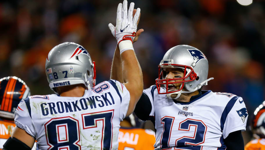 DENVER, CO - NOVEMBER 12:  Quarterback Tom Brady #12 of the New England Patriots celebrates a fourth quarter touchdown with Rob Gronkowski #87 during a game against the Denver Broncos at Sports Authority Field at Mile High on November 12, 2017 in Denver, Colorado. (Photo by Justin Edmonds/Getty Images)