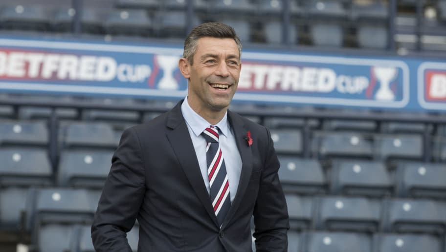 GLASGOW, SCOTLAND - OCTOBER 22: Manager of Rangers Pedro Caixinha walks out to inspect the pitch before the Betfred Cup Semi Final at Hampden Park on October 22, 2017 in Glasgow, Scotland. (Photo by Steve  Welsh/Getty Images)