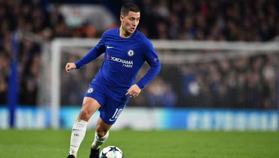 Chelsea's Belgian midfielder Eden Hazard runs with the ball during a UEFA Champions League Group C football match between Chelsea and Atletico Madrid at Stamford Bridge in London on December 5, 2017. / AFP PHOTO / Glyn KIRK        (Photo credit should read GLYN KIRK/AFP/Getty Images)