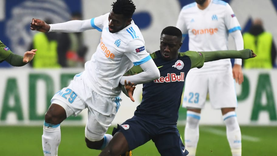 Olympique de Marseille's French midfielder Andre-Frank Zambo Anguissa (L) vies with Salzburg's midfielder from Mali Diadié Samassékou (R) during the UEFA Europa League group I football match Marseille vs Salzburg on Décember 07, 2017 at the Velodrome stadium in Marseille, southern France. / AFP PHOTO / ANNE-CHRISTINE POUJOULAT        (Photo credit should read ANNE-CHRISTINE POUJOULAT/AFP/Getty Images)