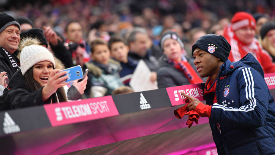 MUNICH, GERMANY - NOVEMBER 18: David Alaba of FC Bayern Muenchen takes a picture with a supporter prior to  the Bundesliga match between FC Bayern Muenchen and FC Augsburg at Allianz Arena on November 18, 2017 in Munich, Germany. (Photo by Sebastian Widmann/Bongarts/Getty Images)