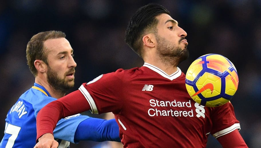 Liverpool's German midfielder Emre Can (R) controls the ball in front of Brighton's English striker Glenn Murray (L) during the English Premier League football match between Brighton and Hove Albion and Liverpool at the American Express Community Stadium in Brighton, southern England on December 2, 2017. / AFP PHOTO / Glyn KIRK / RESTRICTED TO EDITORIAL USE. No use with unauthorized audio, video, data, fixture lists, club/league logos or 'live' services. Online in-match use limited to 75 images, no video emulation. No use in betting, games or single club/league/player publications.  /         (Photo credit should read GLYN KIRK/AFP/Getty Images)