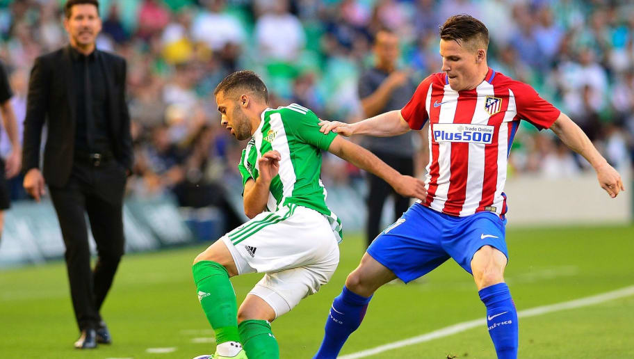 Betis Danish Defender Riza Durmisi L Fights For The Ball With Atletico Madrids