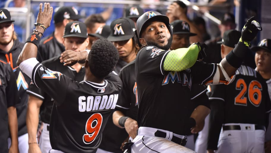 MIAMI, FL - SEPTEMBER 02: Marcell Ozuna #13 of the Miami Marlins is congratulated by Dee Gordon #9 after hitting a home run in the first inning against the Philadelphia Phillies at Marlins Park on September 2, 2017 in Miami, Florida. (Photo by Eric Espada/Getty Images)