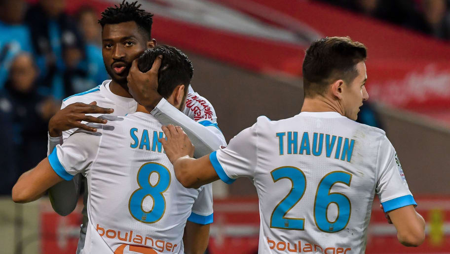 Marseille's French midfielder Morgan Sanson (L) celebrates after scoring a goal with Marseille's Cameroonian midfielder Andre Zambo Anguissa (C) and Marseille's midfielder Florian Thauvin during the French L1 football match between Lille OSC (LOSC) and Olympique de Marseille (OM) on October 29, 2017 at the Pierre-Mauroy Stadium in Villeneuve d'Ascq, northern France. / AFP PHOTO / PHILIPPE HUGUEN        (Photo credit should read PHILIPPE HUGUEN/AFP/Getty Images)
