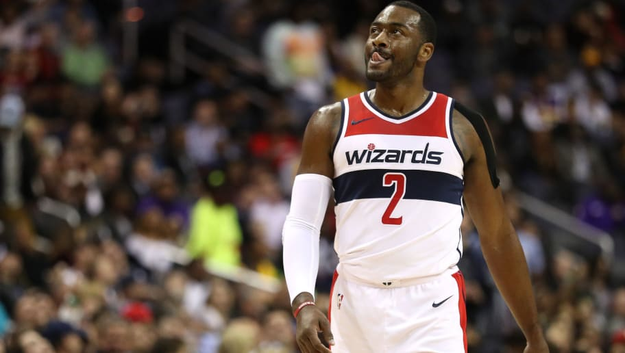 WASHINGTON, DC - NOVEMBER 09: John Wall #2 of the Washington Wizards looks on against the Los Angeles Lakers during the first half at Capital One Arena on November 9, 2017 in Washington, DC. NOTE TO USER: User expressly acknowledges and agrees that, by downloading and or using this photograph, User is consenting to the terms and conditions of the Getty Images License Agreement. (Photo by Patrick Smith/Getty Images)
