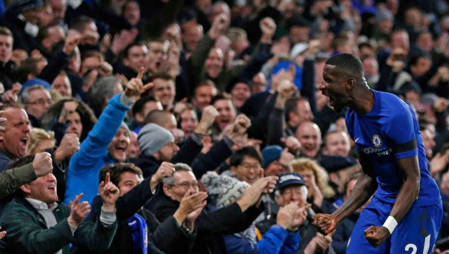 Chelsea's German defender Antonio Rudiger celebrates after scoring the opening goal of the English Premier League football match between Chelsea and Swansea City at Stamford Bridge in London on November 29, 2017. / AFP PHOTO / Ian KINGTON / RESTRICTED TO EDITORIAL USE. No use with unauthorized audio, video, data, fixture lists, club/league logos or 'live' services. Online in-match use limited to 75 images, no video emulation. No use in betting, games or single club/league/player publications.  /         (Photo credit should read IAN KINGTON/AFP/Getty Images)