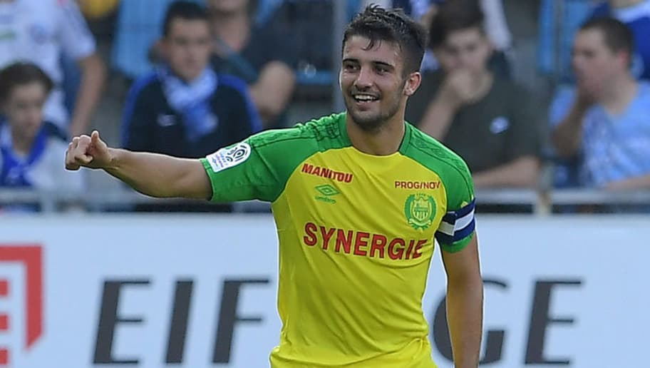 Nantes' French defender Leo Dubois celebrates after scoring a goal during the French Ligue 1 football match between Strasbourg (RCSA) and Nantes (FCNA) on September 24, 2017 at the Meinau stadium in Strasbourg, eastern France.  / AFP PHOTO / PATRICK HERTZOG        (Photo credit should read PATRICK HERTZOG/AFP/Getty Images)