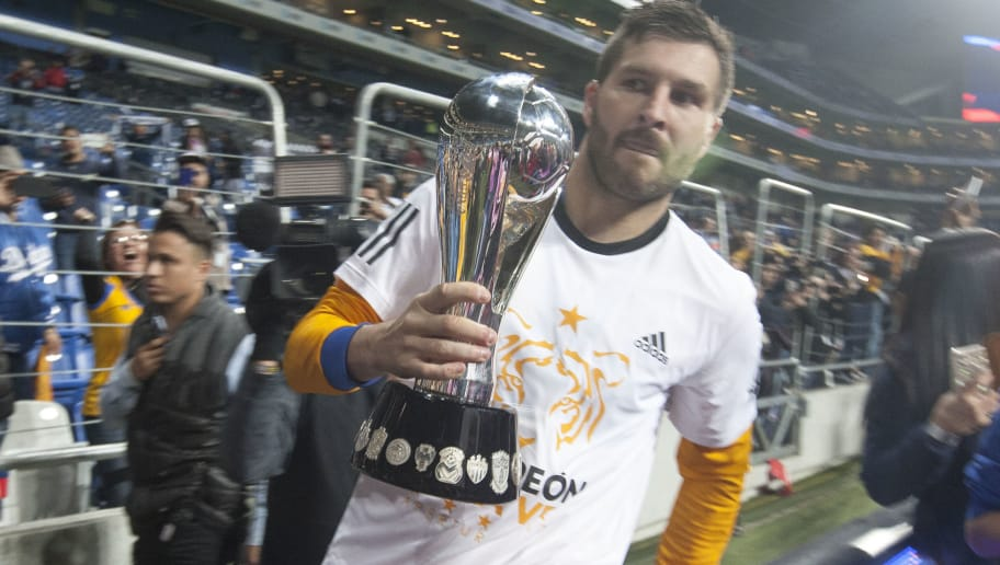 Tigres's Andre Pierre Gignac celebrates with the trophy after defeating Monterrey during their Mexican Apertura 2017 tournament football final match at the BBVA Bancomer stadium in Monterrey, Mexico. On December 10, 2017.  / AFP PHOTO / Julio Cesar AGUILAR        (Photo credit should read JULIO CESAR AGUILAR/AFP/Getty Images)