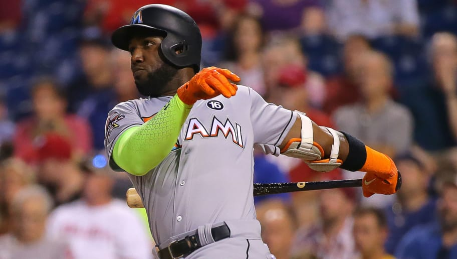 PHILADELPHIA, PA - AUGUST 22: Marcell Ozuna #13 of the Miami Marlins hits a two-run home run in the first inning during game two of a doubleheader against the Philadelphia Phillies at Citizens Bank Park on August 22, 2017 in Philadelphia, Pennsylvania. (Photo by Hunter Martin/Getty Images)