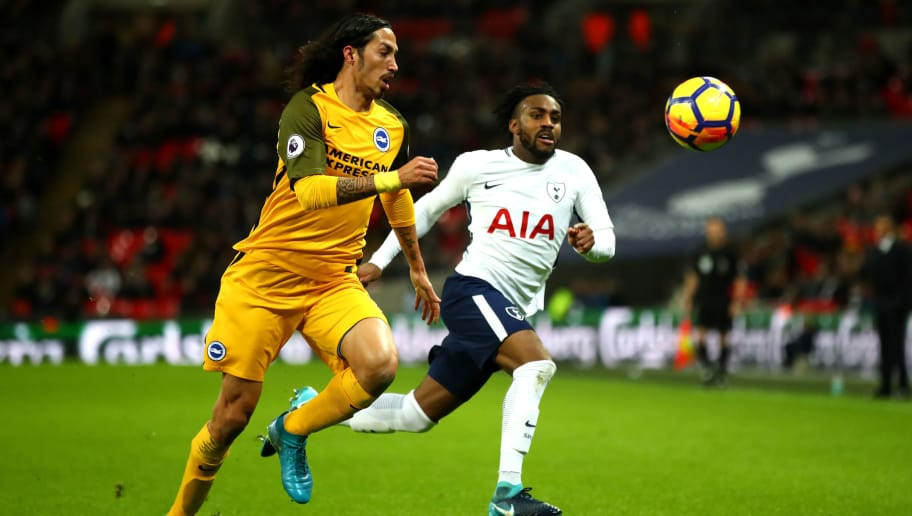 LONDON, ENGLAND - DECEMBER 13: Matias Ezequiel Schelotto of Brighton and Hove Albion is put under pressure by Danny Rose of Tottenham Hotspur during the Premier League match between Tottenham Hotspur and Brighton and Hove Albion at Wembley Stadium on December 13, 2017 in London, England.  (Photo by Julian Finney/Getty Images)