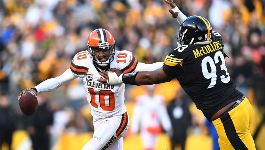 PITTSBURGH, PA - JANUARY 01:  Robert Griffin III #10 of the Cleveland Browns tries to avoid the oncoming rush of Dan McCullers-Sanders #93 of the Pittsburgh Steelers in the overtime period during the game at Heinz Field on January 1, 2017 in Pittsburgh, Pennsylvania. (Photo by Joe Sargent/Getty Images)