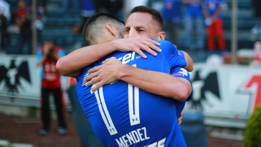 MEXICO CITY, MEXICO - SEPTEMBER 16: Christian Gimenez of Cruz Azul celebrates with teammate Edgar Méndez after scoring the second goal of his team during the 9th round match between Cruz Azul and Santos Laguna as part of the Torneo Aperura 2017 Liga MX at Azul Stadium on September 16, 2017 in Mexico City, Mexico. (Photo by Hector Vivas/Getty Images)