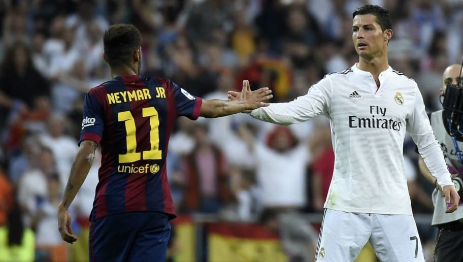Barcelona's Brazilian forward Neymar da Silva Santos Junior (L) congratulates Real Madrid's Portuguese forward Cristiano Ronaldo on winning after the Spanish league 'Clasico' football match Real Madrid CF vs FC Barcelona at the Santiago Bernabeu stadium in Madrid on October 25, 2014. Real Madrid won the match 3-1.  AFP PHOTO / GERARD JULIEN        (Photo credit should read GERARD JULIEN/AFP/Getty Images)