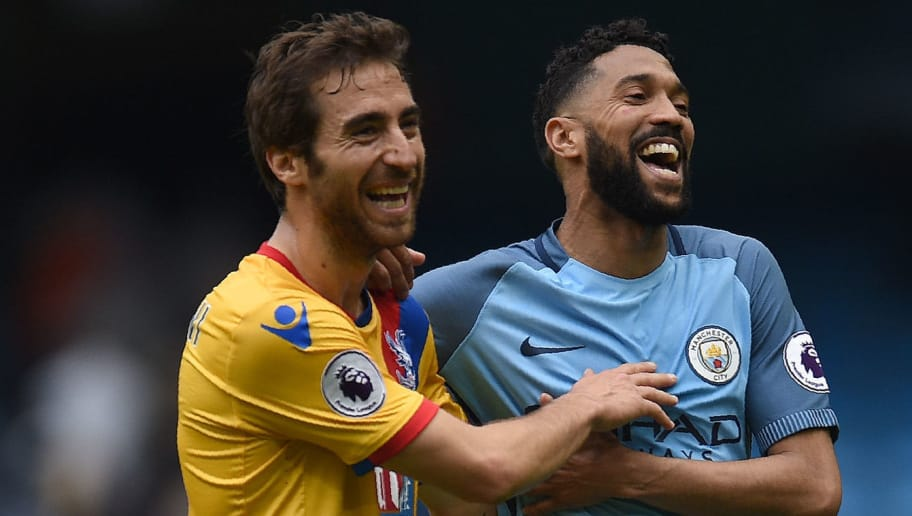 Crystal Palace's French midfielder Mathieu Flamini (L) jokes with Manchester City's French defender Gael Clichy following the English Premier League football match between Manchester City and Crystal Palace at the Etihad Stadium in Manchester, north west England, on May 6, 2017. Manchester City won the match 5-0. / AFP PHOTO / Oli SCARFF / RESTRICTED TO EDITORIAL USE. No use with unauthorized audio, video, data, fixture lists, club/league logos or 'live' services. Online in-match use limited to 75 images, no video emulation. No use in betting, games or single club/league/player publications.  /         (Photo credit should read OLI SCARFF/AFP/Getty Images)