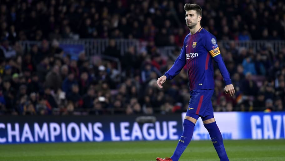 BARCELONA, SPAIN - DECEMBER 05:  Gerard Pique of Barcelona looks on during the UEFA Champions League group D match between FC Barcelona and Sporting CP at Camp Nou on December 5, 2017 in Barcelona, Spain.  (Photo by Alex Caparros/Getty Images)
