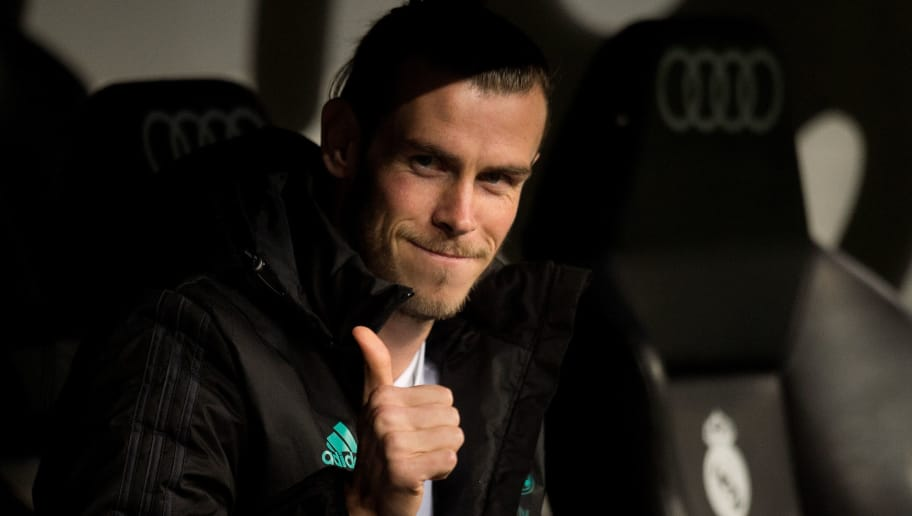 MADRID, SPAIN - NOVEMBER 28: Gareth Bale of Real Madrid CF salutes ballboys from the substitutes bench before the Copa del Rey, Round of 32, Second Leg match between Real Madrid and Fuenlabrada at Estadio Santiago Bernabeu on November 28, 2017 in Madrid, Spain. (Photo by Denis Doyle/Getty Images)