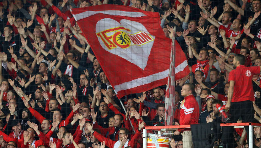 BERLIN, GERMANY - SEPTEMBER 25:  Supporters of Berlin celebrate their team during the Second Bundesliga match between 1. FC Union Berlin and 1. FC Kaiserslautern at Stadion An der Alten Foersterei on September 25, 2017 in Berlin, Germany. (Photo by Matthias Kern/Bongarts/Getty Images)