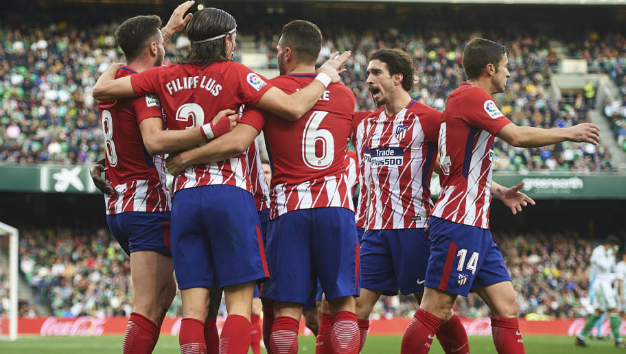 SEVILLE, SPAIN - DECEMBER 10:  Saul Niguez of Club Atletico de Madrid celebrates after scoring the first goal for Club Atletico de Madrid with his team mates during the La Liga match between Real Betis and Atletico Madrid at Estadio Benito Villamarin on December 10, 2017 in Seville,  Spain. (Photo by Aitor Alcalde/Getty Images)