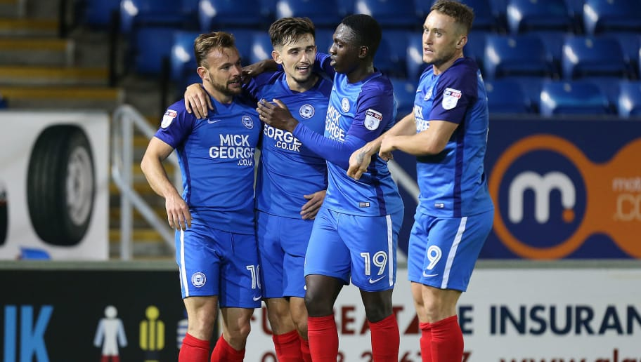 PETERBOROUGH, ENGLAND - OCTOBER 03: Danny Lloyd of Peterborough United celebrates with team mates after scoring his sides first goal during the Checkatrade Trophy match between Peterborough United and Northampton Town at The Abex Stadium on October 3, 2017 in Peterborough, England.  (Photo by Pete Norton/Getty Images)