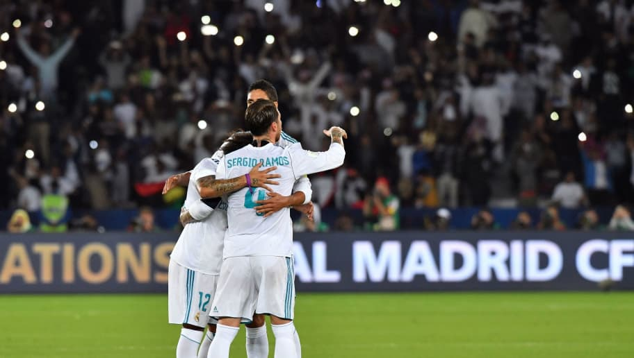 Real Madrid's Brazilian defender Marcelo (L) celebrates with Spanish defender Sergio Ramos (C) and French defender Raphael Varane after winning FIFA Club World Cup 2017 final football match at Zayed Sports City Stadium in the Emirati capital Abu Dhabi on December 16, 2017. Real Madrid defeated Gremio 1-0 to lift the FIFA Club World Cup for the third time in their history. / AFP PHOTO / Giuseppe CACACE        (Photo credit should read GIUSEPPE CACACE/AFP/Getty Images)