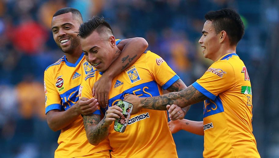 MEXICO CITY, MEXICO - OCTOBER 28: Eduardo Vargas (C)   of Tigres celebrates with teammates Rafael de Souza (L) and Lucas Zelarayan (R) after scoring his team's second goal during the 15th round match between Cruz Azul and Tigres UANL as part of the Torneo Apertura 2017 Liga MX at Azul Stadium on October 28, 2017 in Mexico City, Mexico. (Photo by Manuel Velasquez/Getty Images)