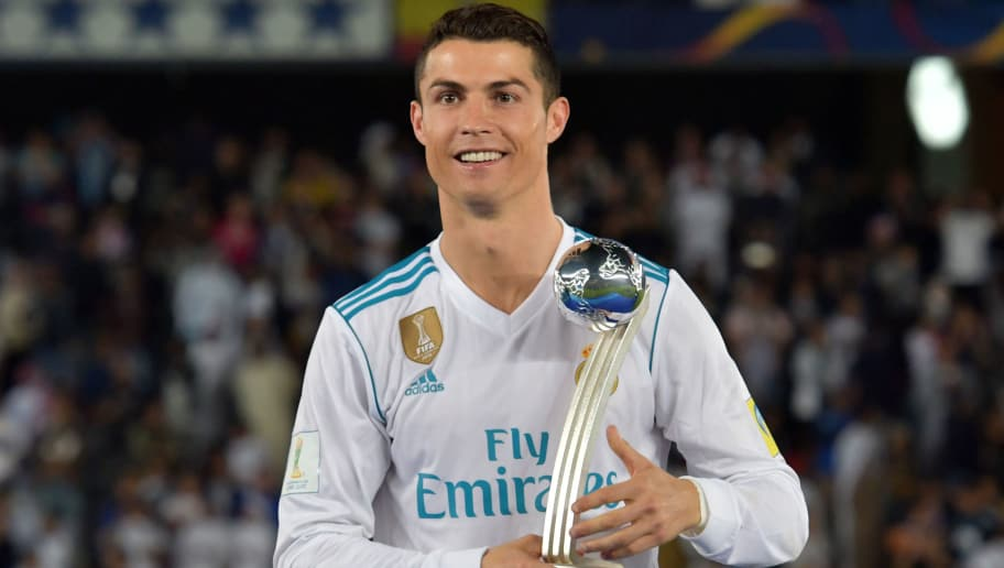 Real Madrid's Portuguese forward Ronaldo celebrates with the 2017 FIFA Club World Cup Silver Ball award following their victory in the Club World Cup final football match against Gremio at Zayed Sports City Stadium in the Emirati capital Abu Dhabi on December 16, 2017. Real Madrid defeated Gremio 1-0 to lift the FIFA Club World Cup for the third time in their history. / AFP PHOTO / Giuseppe CACACE        (Photo credit should read GIUSEPPE CACACE/AFP/Getty Images)