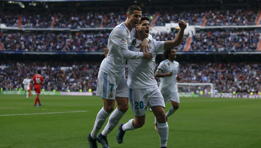 MADRID, SPAIN - DECEMBER 09: Cristiano Ronaldo (L) of Real Madrid CF celebrates scoring their second goal with teammate Marco Asensio (R) during the La Liga match between Real Madrid CF and Sevilla FC at Estadio Santiago Bernabeu on December 9, 2017 in Madrid, Spain . (Photo by Gonzalo Arroyo Moreno/Getty Images)