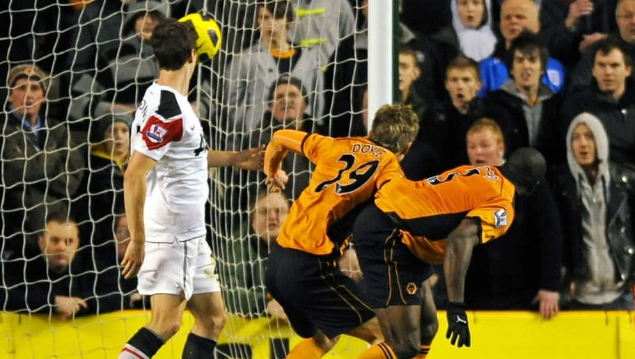 Wolverhampton Wanderers' Cameroonian defender George Elokobi (R) and team-mate, Irish striker Kevin Doyle (2nd R) watch the ball hit the back of the net for their second goal in front of Manchester United's Northern Irish defender Jonny Evans (L) during the English Premier League football match between Wolverhampton Wanderers and Manchester United at Molineux Stadium in Wolverhampton, West Midlands, England on February 5, 2011. The game finished 2 - 1 to Wolves, it was Manchester United's first defeat of the 2010/11 season. AFP PHOTO/ADRIAN DENNISFOR EDITORIAL USE ONLY Additional licence required for any commercial/promotional use or use on TV or internet (except identical online version of newspaper) of Premier League/Football League photos. Tel DataCo +44 207 2981656. Do not alter/modify photo. (Photo credit should read ADRIAN DENNIS/AFP/Getty Images)
