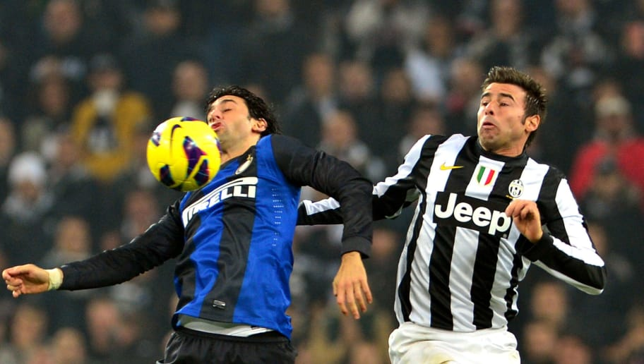 Juventus defender  Andrea Barzagli (R) fights for the ball with Inter Milan's Argentinian forward Diego Alberto Milito on November 3, 2012 during a Serie A football match at the Juventus Stadium in Turin. AFP PHOTO / GIUSEPPE CACACE        (Photo credit should read GIUSEPPE CACACE/AFP/Getty Images)