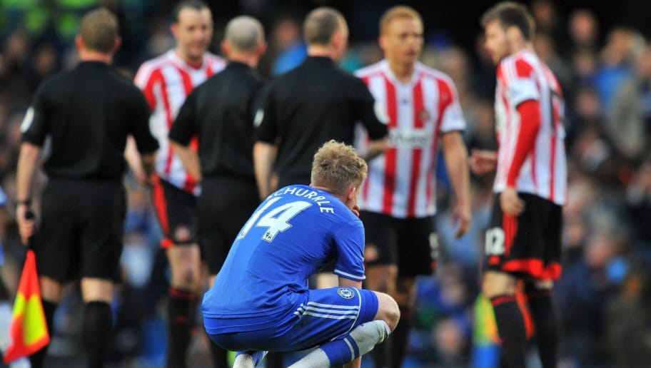 Chelsea's German midfielder Andre Schurrle (Foreground) gestures after his team lost 1-2 during the English Premier League football match between Chelsea and Sunderland at Stamford Bridge in London on April 19, 2014. AFP PHOTO / GLYN KIRK  RESTRICTED TO EDITORIAL USE. No use with unauthorized audio, video, data, fixture lists, club/league logos or live services. Online in-match use limited to 45 images, no video emulation. No use in betting, games or single club/league/player publications.        (Photo credit should read GLYN KIRK/AFP/Getty Images)