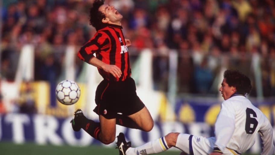 28 NOV 1993:  ROBERTO DONADONI OF AC MILAN IS FOULED BY ROBERTO SENSINI OF PARMA DURING THEIR ITALIAN SERIE A MATCH PLAYED AT THE ENNIO TARDINI STADIUM. Mandatory Credit: Clive Brunskill/ALLSPORT