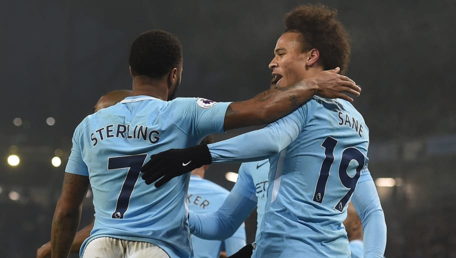Manchester City's English midfielder Raheem Sterling (L) celebrates after scoring their third goal with Manchester City's German midfielder Leroy Sane during the English Premier League football match between Manchester City and Tottenham Hotspur at the Etihad Stadium in Manchester, north west England, on December 16, 2017. / AFP PHOTO / PAUL ELLIS / RESTRICTED TO EDITORIAL USE. No use with unauthorized audio, video, data, fixture lists, club/league logos or 'live' services. Online in-match use limited to 75 images, no video emulation. No use in betting, games or single club/league/player publications.  /         (Photo credit should read PAUL ELLIS/AFP/Getty Images)