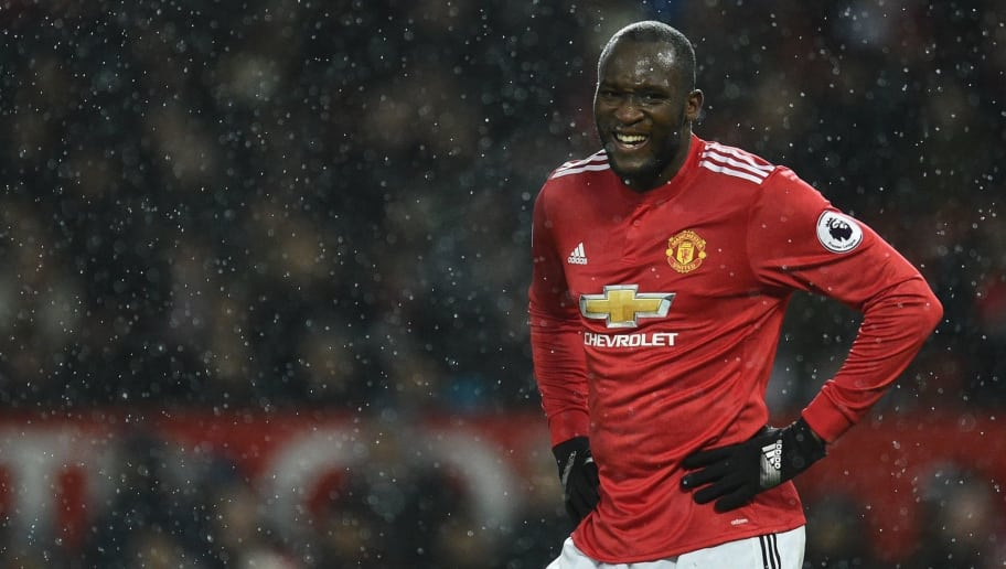 Manchester United's Belgian striker Romelu Lukaku looks on during the English Premier League football match between Manchester United and Bournemouth at Old Trafford in Manchester, north west England, on December 13, 2017. / AFP PHOTO / Oli SCARFF / RESTRICTED TO EDITORIAL USE. No use with unauthorized audio, video, data, fixture lists, club/league logos or 'live' services. Online in-match use limited to 75 images, no video emulation. No use in betting, games or single club/league/player publications.  /         (Photo credit should read OLI SCARFF/AFP/Getty Images)