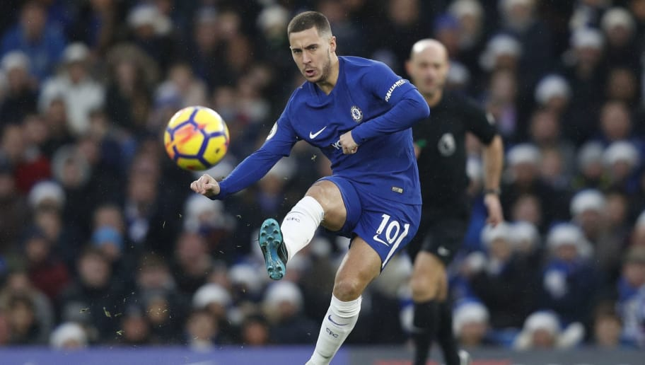 Chelsea's Belgian midfielder Eden Hazard passes the ball during the English Premier League football match between Chelsea and Southampton at Stamford Bridge in London on December 16, 2017. / AFP PHOTO / Adrian DENNIS / RESTRICTED TO EDITORIAL USE. No use with unauthorized audio, video, data, fixture lists, club/league logos or 'live' services. Online in-match use limited to 75 images, no video emulation. No use in betting, games or single club/league/player publications.  /         (Photo credit should read ADRIAN DENNIS/AFP/Getty Images)