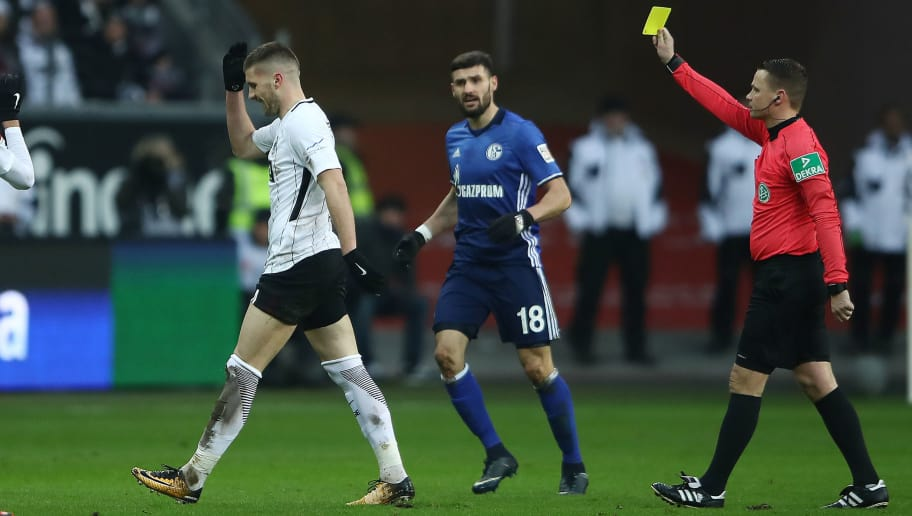 FRANKFURT AM MAIN, GERMANY - DECEMBER 16: Ante Rebic of Frankfurt (2nd left) is shown a yellow card by referee Dr. Robert Kampka during the Bundesliga match between Eintracht Frankfurt and FC Schalke 04 at Commerzbank-Arena on December 16, 2017 in Frankfurt am Main, Germany. (Photo by Alex Grimm/Bongarts/Getty Images)