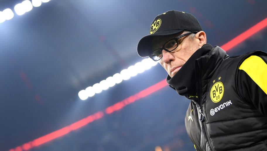 MUNICH, GERMANY - DECEMBER 20:  Peter Stoeger, head coach of Borussia Dortmund looks on prior to the DFB Cup match between Bayern Muenchen and Borussia Dortmund at Allianz Arena on December 20, 2017 in Munich, Germany.  (Photo by Sebastian Widmann/Bongarts/Getty Images)