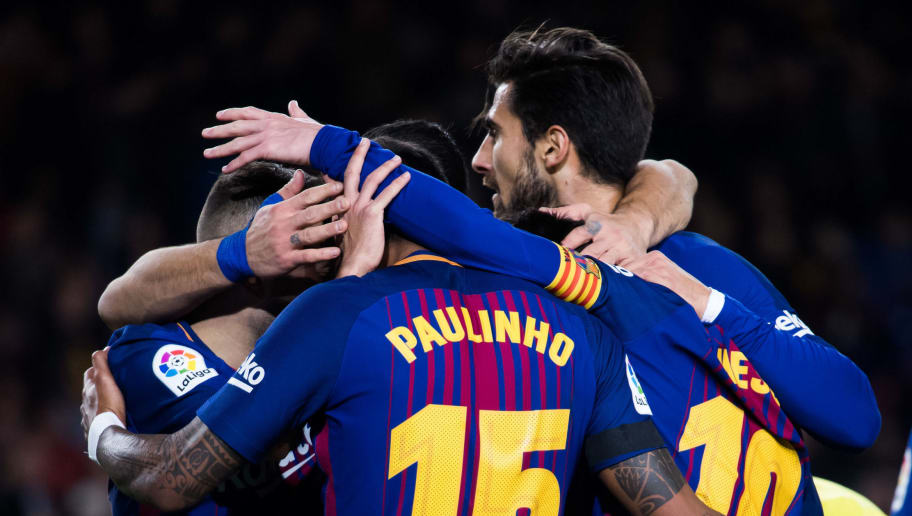 BARCELONA, SPAIN - DECEMBER 17: Players of FC Barcelona celebrate after their teammate Paulinho scored his sides fourth goal during the La Liga match between FC Barcelona and Deportivo La Coruna at Camp Nou on December 17, 2017 in Barcelona, Spain. (Photo by Alex Caparros/Getty Images)