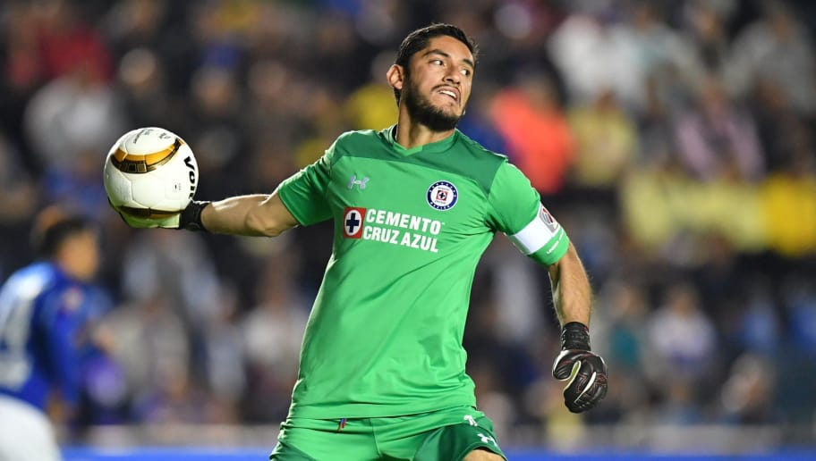 Cruz Azul's goalkeeper Jesus Corona passes the ball during their quarter final, first leg, Mexican Apertura Tournament football match against America at the Azul stadium in Mexico City on November 23, 2017. / AFP PHOTO / YURI CORTEZ        (Photo credit should read YURI CORTEZ/AFP/Getty Images)