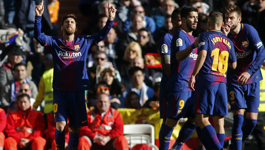 Barcelona's Argentinian forward Lionel Messi (L) celebrates after scoring during the Spanish League 'Clasico' football match Real Madrid CF vs FC Barcelona at the Santiago Bernabeu stadium in Madrid on December 23, 2017.  / AFP PHOTO / OSCAR DEL POZO        (Photo credit should read OSCAR DEL POZO/AFP/Getty Images)