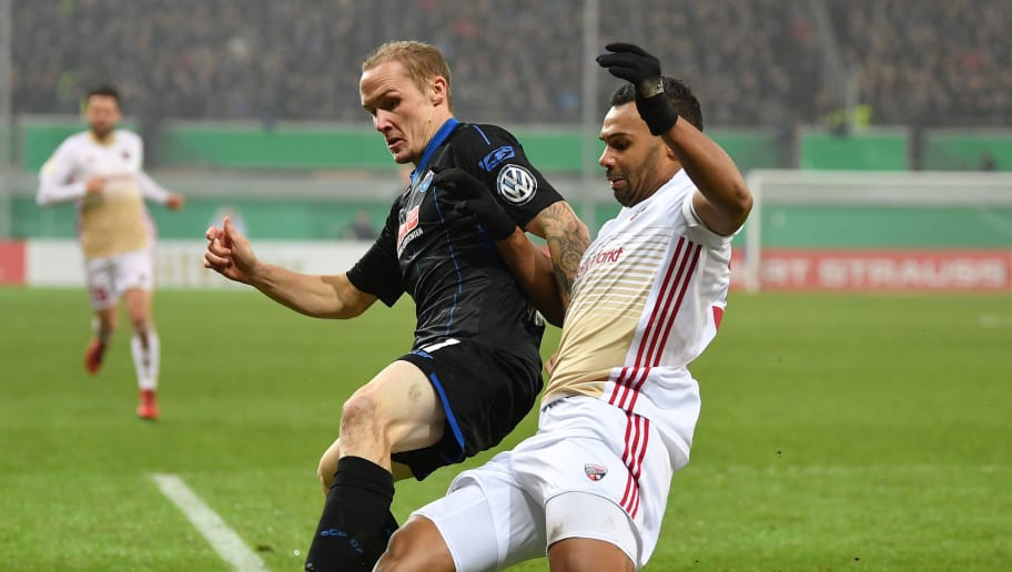 PADERBORN, GERMANY - DECEMBER 19:  Sven Michel of Paderborn is challenged by Marvin Matip of Ingolstadt during the DFB Cup match between SC Paderborn and FC Ingolstadt at Benteler Arena on December 19, 2017 in Paderborn, Germany.  (Photo by Stuart Franklin/Bongarts/Getty Images)
